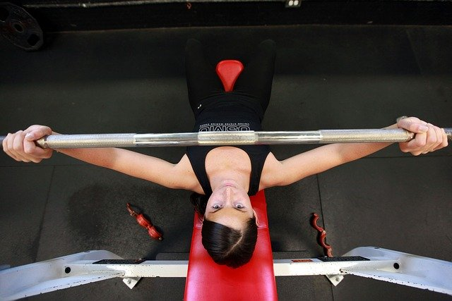 A lady performing bench press